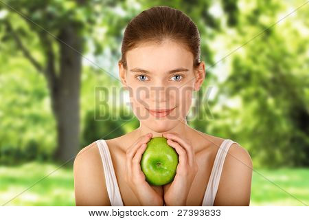 Girl With Apple In Garden