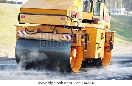 Heavy Vibration roller compactor at asphalt pavement works for road repairing