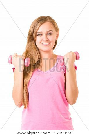 Beautiful smiling girl with free weights in gym