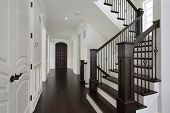 foto of entryway  - Foyer in new construction home with dark wood staircase - JPG
