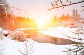 Winter Forest On The River At Sunset. Colorful Landscape With Snowy Trees, Frozen River With Reflect poster
