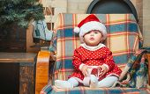 Christmas Babies. Cute Little Baby Child On Christmas Tree Background. Little Baby Girl With A Chris poster