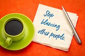 Stop blaming other people - handwriting on a napkin with a cup of coffee poster