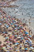 Mediterranean Coastline In Spain. Calpe Beach. Summer Crowd. Alicante Seascape poster