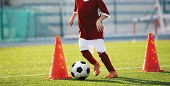 Youth Soccer Practice Drills With Cones. Soccer Drills: Slalom Drill. Young Football Players Trainin poster