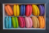 Macarons French Cookies. Macarons Are In A Box On A Marble Background. French Dessert Macarons. Top  poster