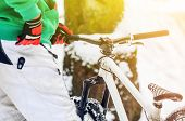 Men Rider Pushes The Extreme Mountain Bike In The Winter Snow-covered Forest. Abstract Extreme Sport poster