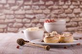 Sweet Dessert From Puff Pastry Filled By Curd Cheese On Wooden Board poster
