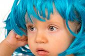 Cute And Stylish. Small Kid In Fancy Wig Hairstyle. Small Child Wear Blue Wig Hair. Adorable Little  poster