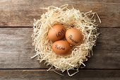 Eggs With Words Pension, Retire And 401k In Nest On Wooden Background, Top View poster