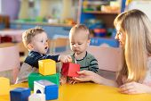 Cute Babies Play With Blocks. Educational Toys For Preschool And Kindergarten Child. Little Boys And poster