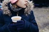 Young Girl Drinking Popular Hot Non-alcoholic Beverage, Called Punsch In German Language. Favourite  poster