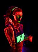 Portrait Of A Beautiful Young Sexy Girl In Headphones With Ultraviolet Paint On Her Body. Pretty Wom poster