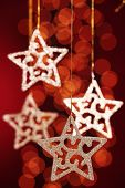 stock photo of christmas star  - Gold stars  over festive  background - JPG