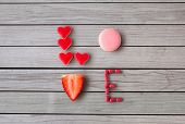 valentines day, sweets and confectionery concept - close up of word love made of red heart shaped ca poster