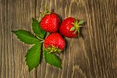 Ripe Strawberries On Wooden Table. Fresh Strawberries On Wooden Background. Ripe Red Strawberries. T poster