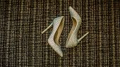 Wedding Shoes. Shoes. Brides Wedding Accessories. Photo Of Brides Shoes On The Sofa. Wedding Charges poster
