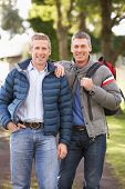 pic of gay couple  - Two Male Friends Walking Outdoors In Autumn Park Together - JPG