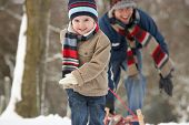 stock photo of sleigh ride  - Children Pulling Sledge Through Winter Landscape - JPG