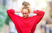 Young braided hair african american girl wearing sweater and glasses over isolated background suffer poster