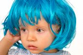 Pure Beauty. Adorable Little Child In Fashion Wig. Small Child Wear Blue Wig Hair. Small Kid In Fanc poster