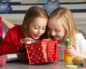 stock photo of school lunch  - Primary School Pupils Enjoying Packed Lunch In Classroom - JPG