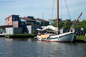 stock photo of flatboat  - Summer housing and flat boat in Heeg  - JPG
