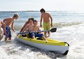 image of teenage boys  - Teenage boys kayaking - JPG