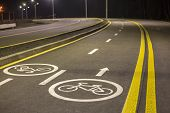 Bicycle Road Markings And Signs. Illuminated Bicycle Lane Travel Lane Reserved For Bicyclists With P poster