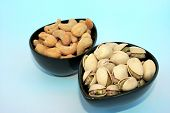 foto of sult  - Different tasty sulted nuts in blue bowls - JPG