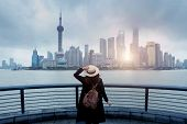 Woman Tourist Is Enjoy Watching Landmark View City Skyline Business District In Shanghai, China. poster