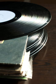 pic of lps  - LPs and covers.Natural light. Vertical image . ** Note: Shallow depth of field - JPG