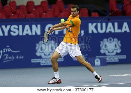 KUALA LUMPUR - SEP 27: Albert Ramos of Spain plays his round 2 match at the ATP Tour Malaysian Open 2012 on September 27, 2012 at the Putra Stadium, Kuala Lumpur, Malaysia. He lost to Kei Nishikori.