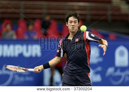 KUALA LUMPUR - SEP 27: Kei Nishikori of Japan plays his round 2 match at the ATP Tour Malaysian Open 2012 on September 27, 2012 at the Putra Stadium, Kuala Lumpur, Malaysia. He defeated Albert Ramos.