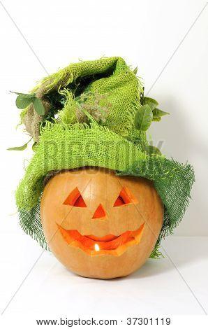 Pumpkin With Green Halloween Hat On