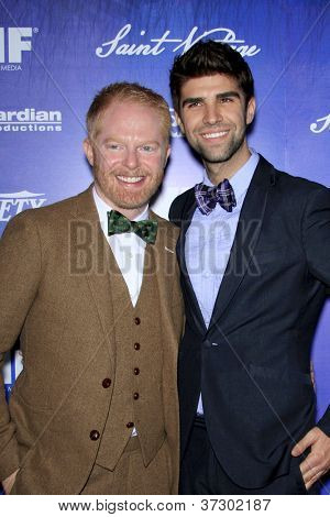 LOS ANGELES - SEP 21:  Jesse Tyler Ferguson, Justin Mikita arrives at the Variety and Women in Film Pre-Emmy Event at Scarpetta on September 21, 2012 in Beverly Hills, CA