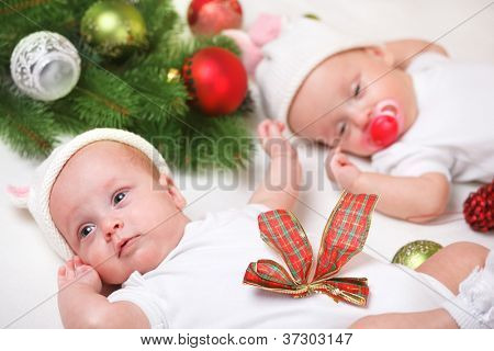 Christmas twin newborn babies in white