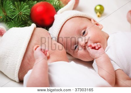 Adorable Christmas twin babies in hats