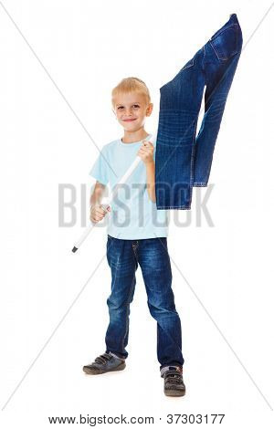Smiling boy waving the flag made of denim wear