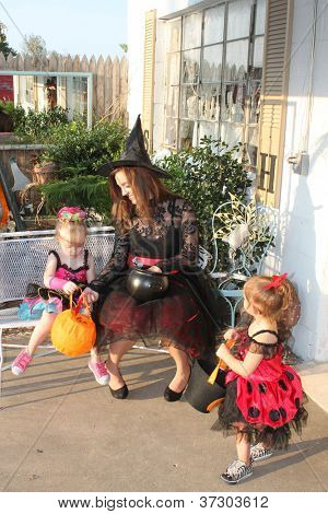 Family checking out candy after evening of Halloween trick or treat