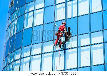 Window washer, lavado de ventanas de edificio de oficinas