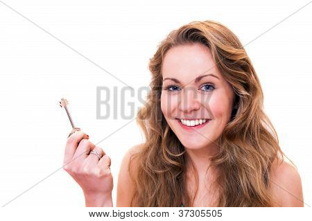 Happy Young Woman Smiling Holding A Door Key