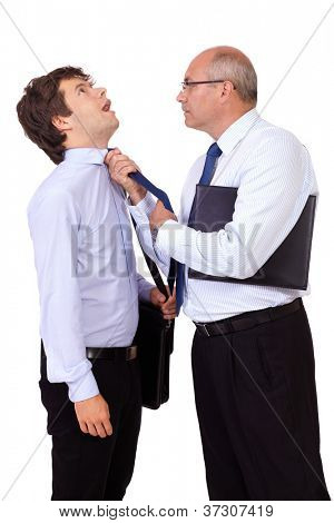 Senior angry businessman with briefcase tearing young businessman at his tie, isolated on white background