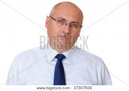 Close portrait of bored senior businessman in blue shirt looking through glasses, isolated on white