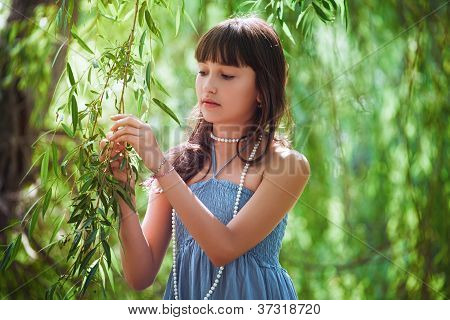Girl staying near a osier