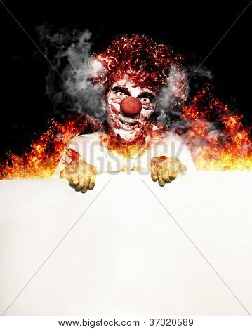 Scary Clown Holding Blank Board In Flames And Fire