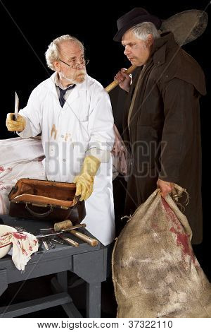 Grave Robber And Evil Doctor With Bloody Cleaver Exchange Glances.