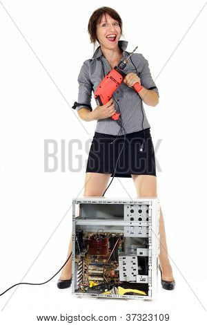 ecstatic business woman destroying computer with electric drill