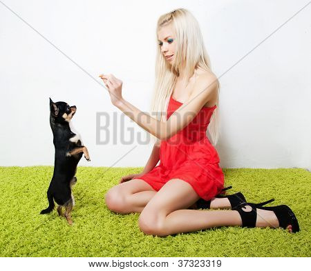 Pretty Woman Blond With Her Friend - Small Black Dog