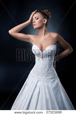 Alluring Sexy Bride Blonde Fashion Model Posing In Studio